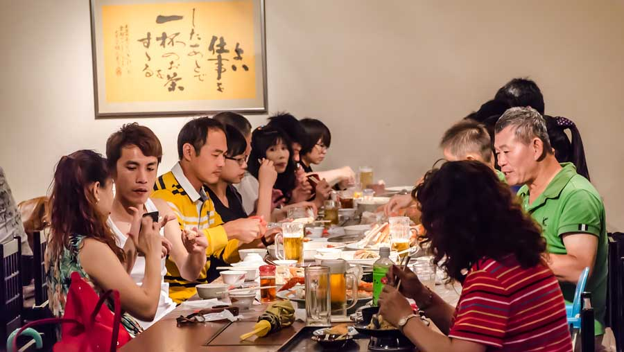bigstock Chinese People In Restaurant 72565741