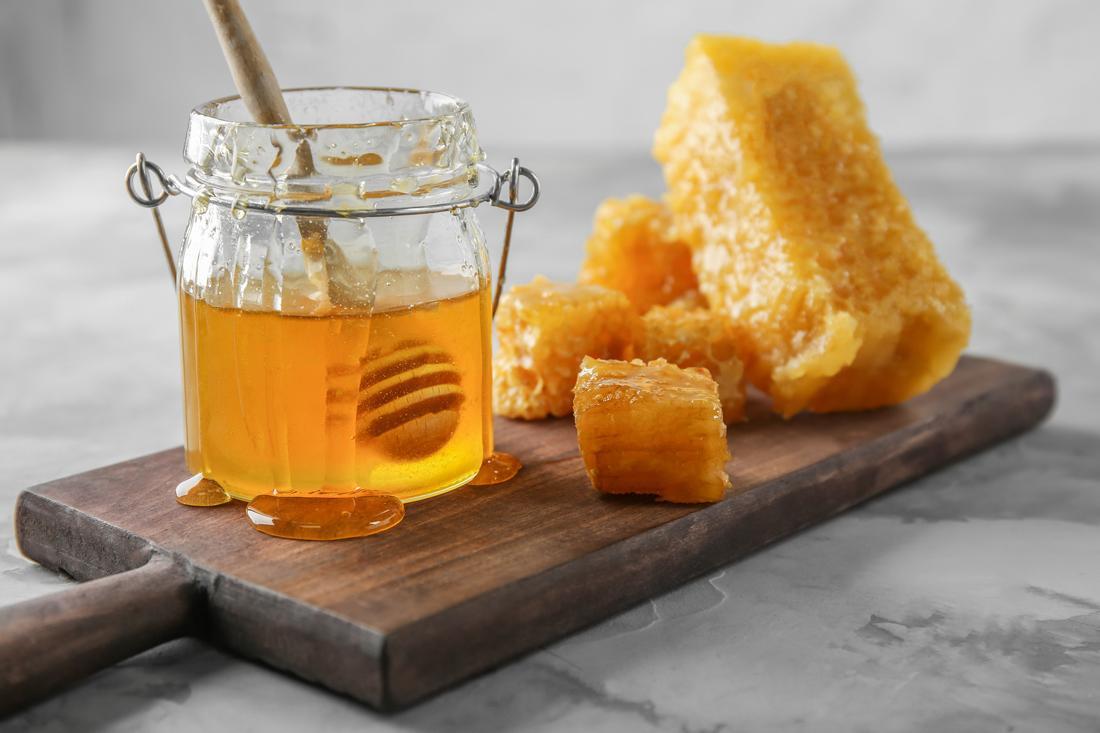 bigstock Combs and jar of sweet honey o 228060895