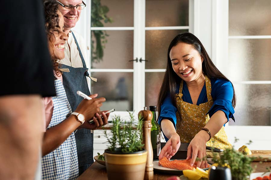 bigstock Diverse people joining cooking 229263874