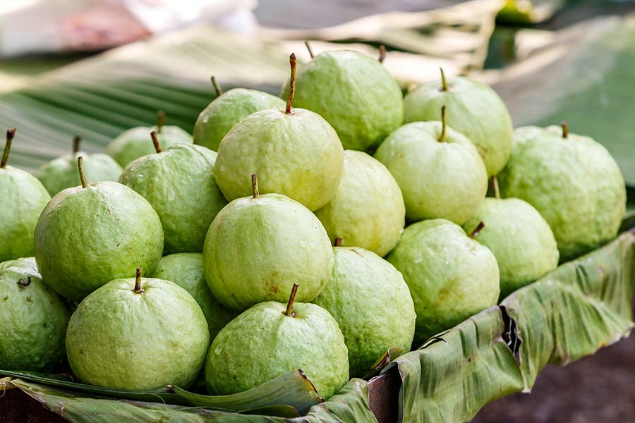 bigstock Green Guava On Banana Leave 116497199