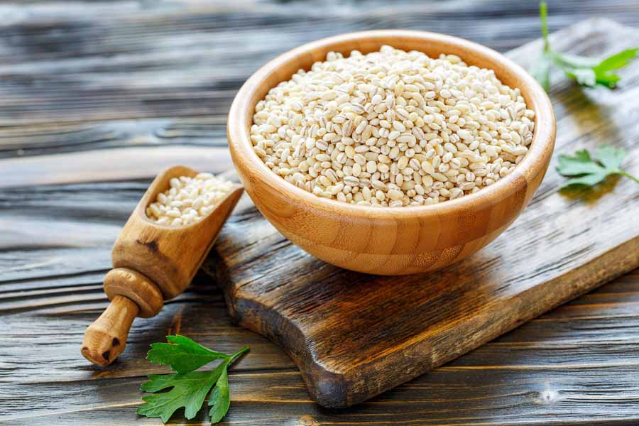 bigstock Pearl Barley In A Wooden Bowl 213661960