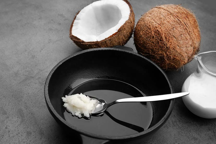 bigstock Spoon with coconut oil on fryi 178835335