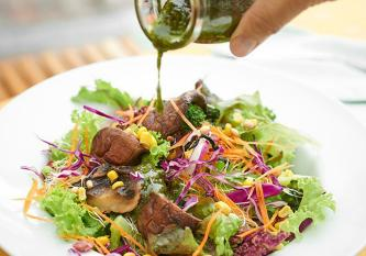 Signature Grilled Portobello Mushroom Salad with Pesto Sauce